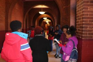 students taking a tour of healy hall